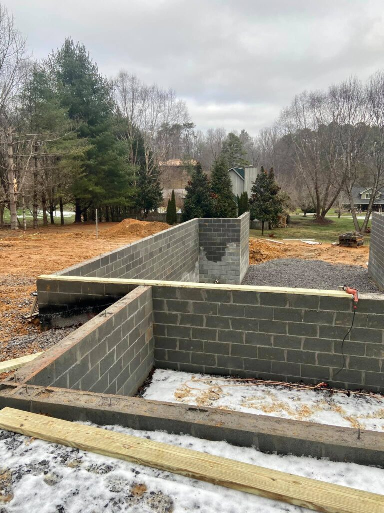 Cinderblock border wall crafted by Smoky Top Construction in Tennessee